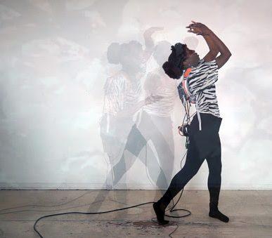 Artist Jenelle Rouse posing in dance